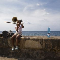 #HAVANA #GIRL by Jens Rosbach #Cuba #Carribean #LatinAmerica #contrast #shadow #light #sun #travelphotography #holiday #outdoor #bay #beach #stonewall #coast #sea #music #trumpet #child #castro  #Closethecircle - if you buy this photo Jens Rosbach and Photocircle #donate 13% to provide communities in #Bolivia with better social infrastructure