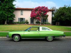 """1976 Chevrolet Caprice 2 door in original """"Lime Green"""" metallic and matching color hubcaps."""