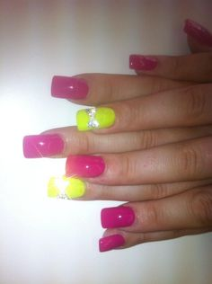 Neon nails with bling bows