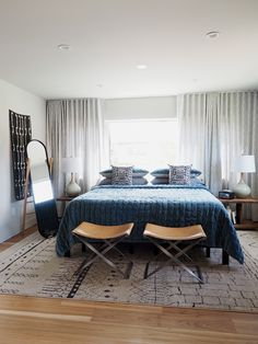 cozy bedroom in blues and neutrals | sunset idea house tour coco+kelley