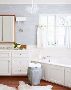 Cynthia Collins - White and blue bathroom with Phillip Jeffries Blue Grasscloth Wallpaper paired with subway tile backsplash and corner paneled jet-spa drop-in tub under window covered in white cafe curtains. Bathroom Spa, Bathroom Interior, Modern Bathroom, Master Bathroom, Bathroom Ideas, Spa Tub, White Bathroom, Lilac Bathroom, Bathroom Goals