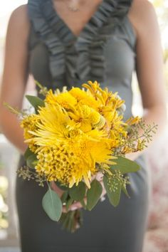 Yellow-Bouquet-Gray-Bridesmaids-Dresses.....I'm liking the gray bridesmaid dresses but not the yellow flowers! I would do bright purples & hot pinks in the bouquets!