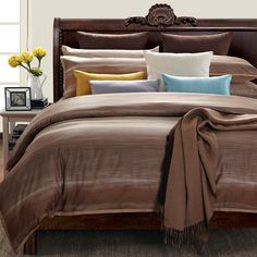 Bring relaxation to your bedroom with a 100 percent cotton Sahara Sun Queen Duvet Set by EverRouge. The 300-count, seven-piece set features a duvet cover with warm brown stripes, two standard and two Euro shams, and gold and lavender accent pillows.