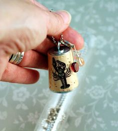 So this is the basic wine cork key chain design. Just an Eye Screw screwed into one end of the cork. You don& drill first, you just thread. Wine Cork Projects, Wine Cork Crafts, Rock Lobster, Wine Cork Ornaments, Christmas Ornament Crafts, Lobsters, Craft Gifts, Cool Things To Make, Purses And Bags