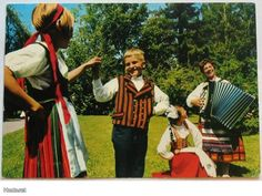 "Finnish folk costumes, the one on the left is Finn-Swedish (though slightly different from the more ""authentic"" or traditional one). The one on the right is Karelian, from Koivisto."