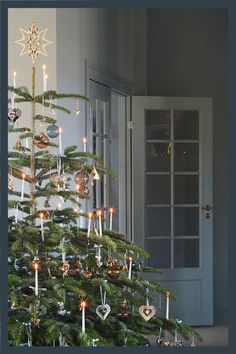 Scandinavian Christmas tree with gold plated ornaments from Georg Jensen. The ornament is beautifully crafted from brass and then 18 karat gold-plated in Georg Jensen's own workshop in Denmark. Christmas Swags, Christmas Tree Toy, Merry Christmas, Christmas Tree Toppers, Christmas Christmas, Minimal Christmas, Swedish Christmas, Rustic Christmas, English Christmas