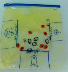 "love the idea of using a sensory bag to work on fine motor skills. Sort the pumpkins, skulls, and ghosts into the right ""goals"""
