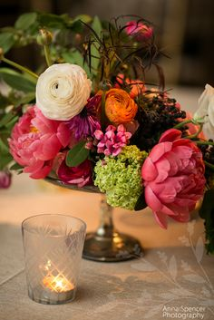 White, pink, orange, and green asymmetrical wedding reception floral arrangement. Anna and Spencer Photography. Amy Osaba florist.