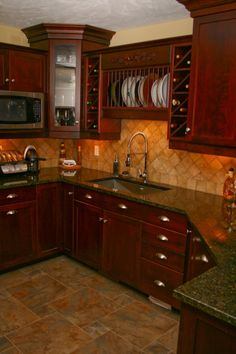 Slate kitchen flooring may be your answer to durability, beauty, and style Kitchen Cabinets And Granite, Slate Kitchen, Backsplash With Dark Cabinets, Kitchen Flooring, Kitchen Tiles, Granite Countertops, Kitchen With Brown Cabinets, Dark Kitchen Floors, Stain Cabinets