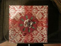Christmas package decoration using Cricut Elegant Edges and flower punch to create center rose.