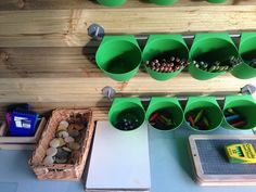 Mark making outside area Early years. Deck boards and ikea storage holders