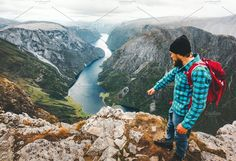 Travel Man with backpack on cliff by e v e r s t on @creativemarket