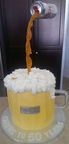 - This was such a fun cake to make. I was surprised how easy it was to put together. Four eight inch cakes stacked with bubble straw supports. Poured beer is isomalt. Beer mug is buttercream icing . Name plate and handle are fondant.