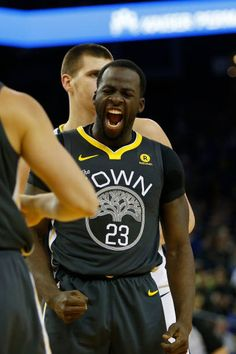 Draymond Green of the Golden State Warriors reacts after making a basket and drawing a foul against the Denver Nuggets at ORACLE Arena on December 23...