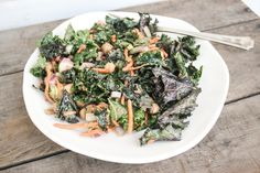 raw kale salad with spicy peanut dressing | Dishing Up the Dirt----For the dressing 3 TBS smooth organic peanut butter 3 TBS warm water 2 1/2 TBS tamari (organic low sodium if possible) 1 garlic clove, minced 1 tsp fresh ginger, minced 1 TBS honey or pure maple syrup 1 tsp sesame oil 1 tsp crushed red pepper flakes