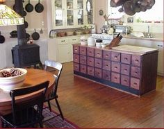 Love the idea of using an old cabinet like this as an island!  Think of all the storage!