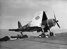Corsair Mk II fighter aboard an escort carrier in the Indian Ocean, note outrigger device which allowed the fighter to extend beyond the flight deck thus saving deck space Source Imperial War Museum Identification Code Military Helicopter, Military Aircraft, Royal Navy Aircraft Carriers, Capital Ship, Ww2 Photos, Naval History, Flight Deck, Ww2 Aircraft, Navy Ships