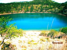 An old picture taken of a once volcano crater turned into a caldera lake — #calderalake #andrography #streamzoo #photography #volcano #crater #nature #trees #lakes • MyajaTani on Streamzoo