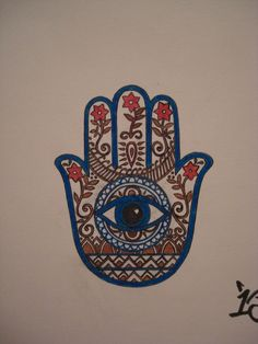 If I were to get another tattoo it'd be the hamsa symbol in black and white.
