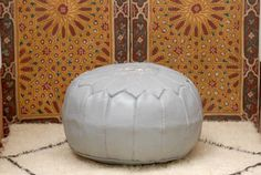 """Exquisite Moroccan leather pouf hand stitched with the finest quality, locally tanned, leather.  Each piece is handcrafted to the highest standard by our artisans in the souks of Marrakech.  .:  Size (approx): 21"""" x 13"""" inches (53 x 33 cms) .:  100% goat's Leather .:  Zip on the underside .:  Ethically handmade in Morocco .:  Automatically shipped with FedEx Express (worldwide shipping time is 3-5 days).  To reduce shipping costs, pouf comes unfilled. Filling your pouf with Polyester Fiber…"""