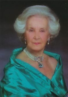Princess Lilian of Sweden wearing a necklace with five rows of pearls with a pendant of aquamarine.