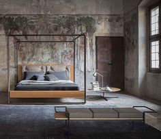 Roberto Lazzeroni outlines a light and airy vision of the classic four-poster bed. His design is for a large structured bed, luxurious in terms of its workmanship and natural materials, yet at the same time discrete and sparing. It is a warm and welcoming...