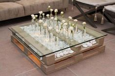 low coffee table with glass table top and beautiful decoration