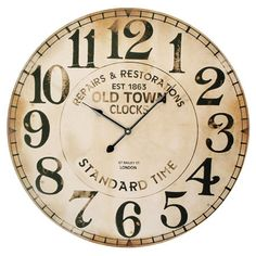 Create a charming country-chic vignette in your living room or home office with this lovely wall clock, featuring a weathered face and typographic detailing....