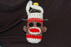Sock Monkey Water Bottle Cozy Crochet Pattern. I use it as a mittens pattern and attach mittens to a kids scarf for chilly weather. Awesome free pattern!