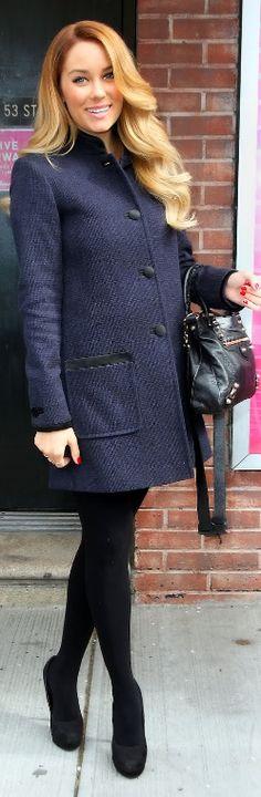 navy blue coat, black pumps and black handbag