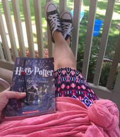 HP, Carly, Cassie, Kicks, & Coffee (at my lips)....what a beautiful Colorado summer day watching neighborhood kids on the slip-n-slide and having water balloon fights! My only rule: Don't get my HP book wet!😂 @lularoe #lularoe #lularoecarly #lularoecassie #harrypotter #feetup #coloradosummer #lularoeknots