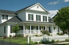 New home with an old country feel. Large front porch and the white picket fence for the old time retro look.
