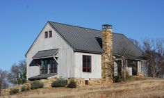 This Texas party barn design can be entered on two levels. A four-vehicle garage is on lower level. Dormers provide north light to the second level. Amazing Architecture, Architecture Design, Bank Barn, Cedar Siding, Modern Stairs, Modern Barn, House Plans, New Homes, Texas