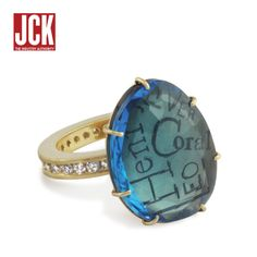 """2012 JCK Award - In the Personalized Jewelry over $1,000 Category. The winning piece, above, is a """"Family Ring"""" with a Swiss blue topaz Harriet stone set on a 2mm channel set band of white diamonds set in 14k yellow gold."""