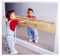 Jonti-Craft's Infant Coordination Mirror- Babies will be entertained while developing motor skills. The wall mounted acrylic mirror will excite babies as they learn to pull up and eventually balance on the hard Maple rail. Montessori Toddler, Montessori Toys, Toddler Toys, Baby Toys, Toddler Classroom, Infant Toddler, Infant Play, Montessori Bedroom, Montessori Classroom