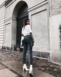 white tshirt, denim, and white ankle boots
