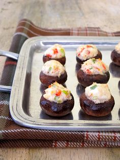 Crab Stuffed Mushrooms - This stuffed mushroom recipe is based on the classic Crab Rangoon, but with added red pepper and green onion for color and crunch.