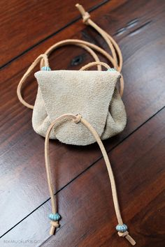 // diy handmade leather medicine pouch //  Put beads on an herb pouch necklace