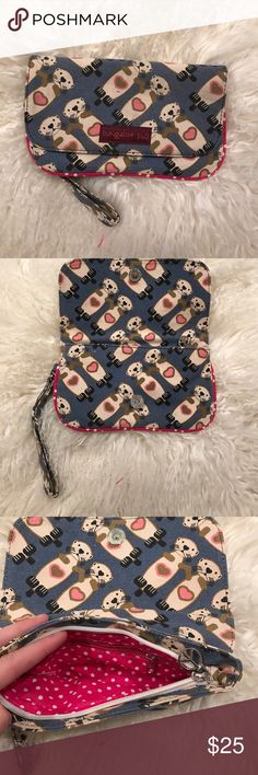 Bungalow 360 clutch Used once, otter print clutch with a zip closure and a zip pocket inside, has a wristband. Bags