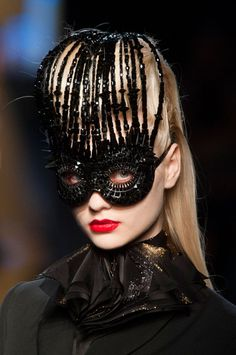 Too wordly for Juliet (our innocent) but interesting play with historical/high fashion and like the mask/hairpiece combo --Jean Paul Gaultier Fall 2014