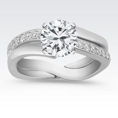 81bd412e7 See her light up with a stunning engagement ring from Shane Co. Our  beautiful wedding rings are as unique as love itself.