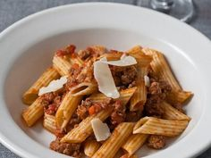 This pasta Bolognese recipe from F&W's Grace Parisi features a traditional combination of ground beef, pork, veal and tomato enriched by smoky pancetta. Wine Recipes, Pasta Recipes, Cooking Recipes, Yummy Recipes, Chimichurri, Italian Dishes, Italian Recipes, Italian Pasta, Sauce Carbonara