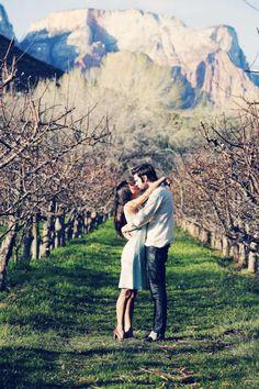 38-engaged-couple-kiss-vintage-vineyard