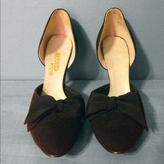Vintage 1960's Black D'Orsay Pumps With Bow These are fantastic vintage shoes that are from the 1960's They are made of a suede like material, and are adorned with a bow made from heavy cross grain ribbon. These would look perfect with a ladylike dress.    These shoes are in excellent vintage condition. There are no noticeable flaws other than some wear on the soles, and a couple very small scuffs near the bottom of the heel.    Sizing:   U.S - 7  Europe - 37.5  Length in Inches - 9.5  These…
