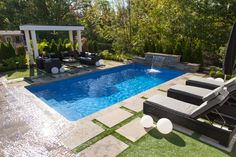 This stunning Rectangle Inground Pool includes Vinyl Over Steel Steps, a Sheer Descent Waterfall and a Deep Full Blue Granite Liner. Check out the entire Pool Showcase here. Inground Pool Designs, Vinyl Pools Inground, Swimming Pool Designs, Pool Liners Inground, Backyard Pool Landscaping, Backyard Pool Designs, Swimming Pools Backyard, Patio, Landscaping Ideas