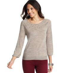 cute sweather with some visual interest and shows some neck. Could wear with jeans and brown boots for a casual look, or dress up with black jeans heels and a blazer for a party