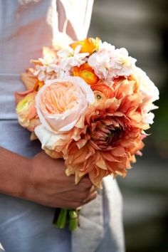 Peach-Orange-Bouquet. just how i describe my florals. maybe without the dahlia in the front, but GREAT bouquet and colors especially for bridesmaids. throw a little greenery in there and done.