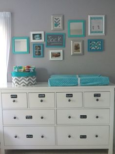Organized space kept simple with gray walls and a turquoise brought in using frames and the changing pad