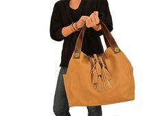 This oversized hobo bag its very comfortable and has plenty of space to carry all your staff. Its double handle provides extra strength, and it has pretty details such as its big opaque bronze studs. This leather provides amazing softness and flexibility.  Hand-made from genuine ivory cow leather. There might be other colors available, such as brown, caramel, black, navy blue, ... Please do not hesitate to ask, we'll be glad to custom-made it for you!  Inside: fabric lining, inside pocket…