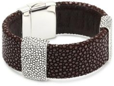 """Zina Sterling Silver """"Stingray Collection"""" Stingray Station Strap Bracelet Zina Sterling Silver. $520.00. Stingray is a natural skin and the pattern and color saturation will vary slightly. Brown stingray strap bracelet with stingray embossed design in sterling silver. Concealed 'foldover clasp' creates a continuous look. Made in USA"""